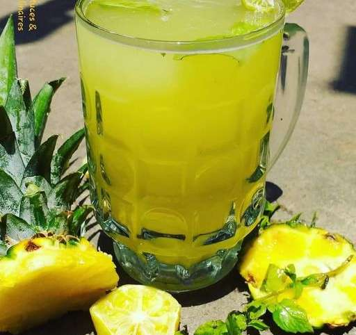 Boisson rafraîchissante, désaltérante à base d'ananas, gingembre, citron et menthe